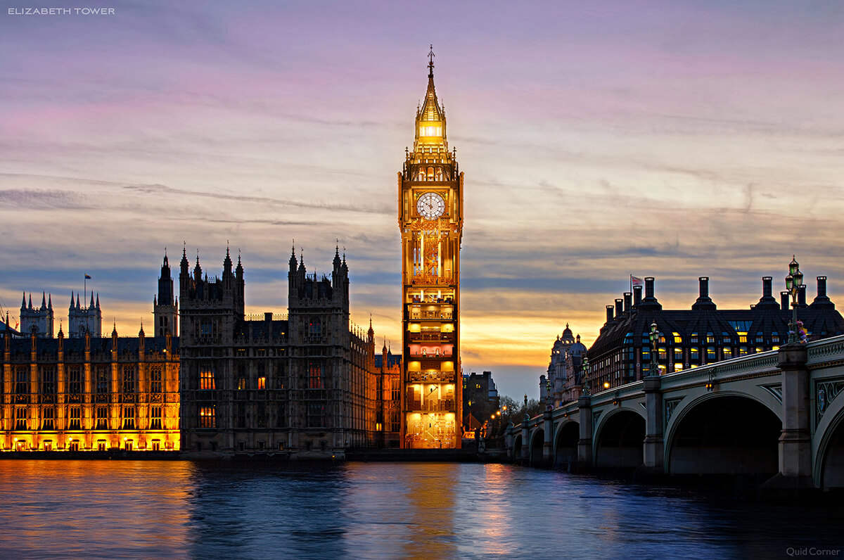 evening view of Big Ben, the famous clock town in london, over a river