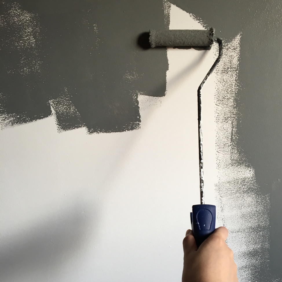 White wall mid-paint with grey, painted by paint roller